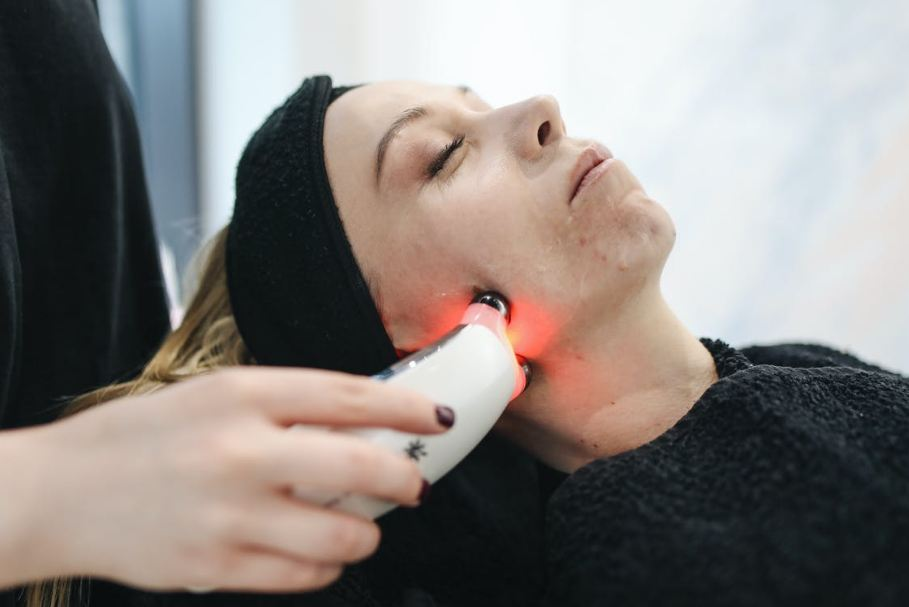 woman have a facial care using laser