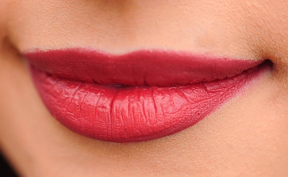 A Close-up of lips appearing fuller due to dark color
